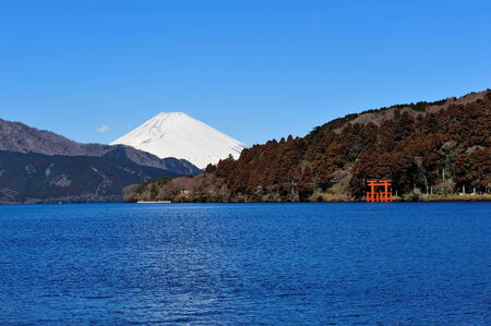 temperate: Hakone Lake and Mount Fuji in Japan, with a torii gate from Hakone