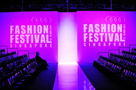 spectator: SINGAPORE - MAY 17: Logo and spectator gallery of Audi Fashion Festival 2011 on May 17, 2011 in Singapore. Editorial