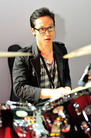 swarovski: SINGAPORE - MAY 18: Drummer performing during Swarovski show at Audi Fashion Festival 2012 on May 18, 2012 in Singapore Editorial