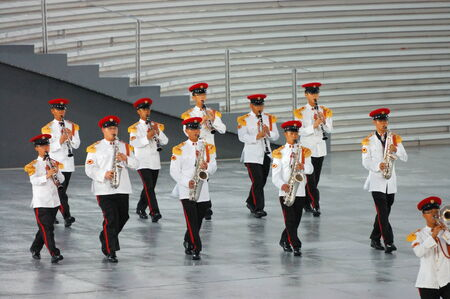 contingent: SINGAPORE - AUGUST 9: Military band contingent performing during National Day Parade August 9, 2008 in Singapore Editorial