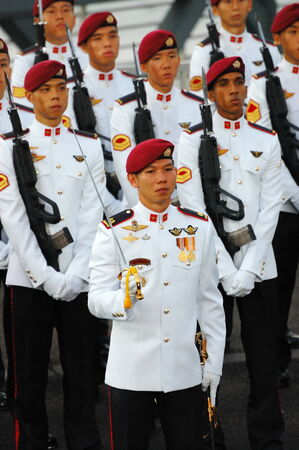 commando: SINGAPORE - AUGUST 9: Commando Guard-of-Honor contingent during National Day Parade August 9, 2008 in Singapore