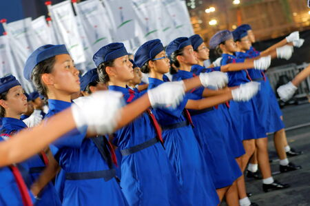 contingent: SINGAPORE - JULY 11: Girl guide contingent marching during National Day Parade Combine Rehearsal July 11, 2009 in Singapore