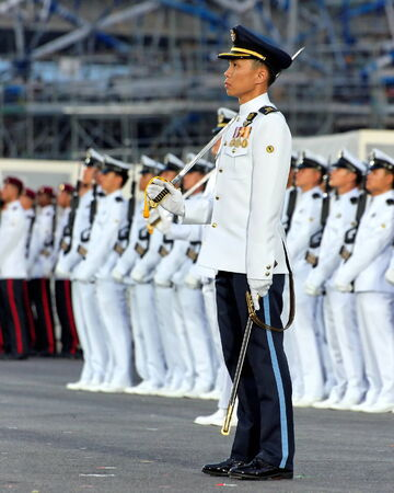 contingent: SINGAPORE - JULY 04: Parade Commander LTC Yeong Chee Meng standing at attention during Singapore National Day Parade 2009 combined rehearsal at Marina Floating Platform July 04, 2009 in Singapore.