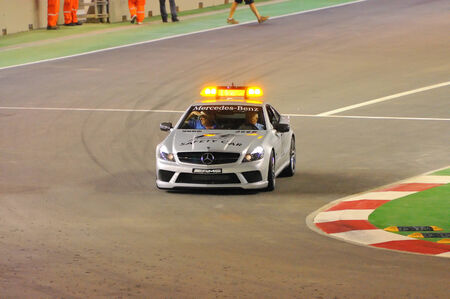 SINGAPORE - SEPTEMBER 26: Formula One safety car approaching corner during first night race September 26, 2008 in Singapore