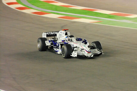 nick: SINGAPORE - SEPTEMBER 26: Nick Heidfeld driving his BMW Sauber during first Formula One night race September 26, 2008 in Singapore Editorial