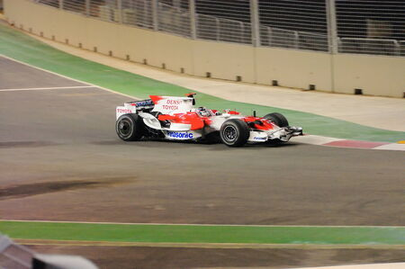 SINGAPORE - SEPTEMBER 26: Jarno Trulli cornering in his Toyota during first Formula One night race September 26, 2008 in Singapore