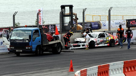 SINGAPORE - JULY 05: Damaged white coupe being towed away during Formula Drift Singapore 2009 Pro-am Series July 05, 2009 in Singapore.