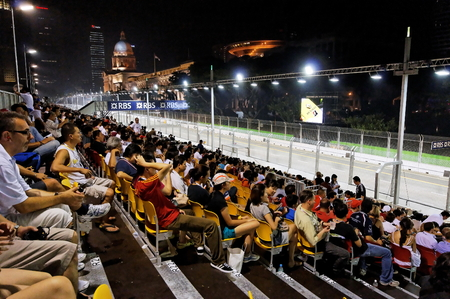 prix: SINGAPORE - SEPTEMBER 26: F1 fans at the 2009 Formula One Singapore Singtel Grand Prix grand stand September 26, 2009 in Singapore.
