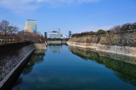 moat: Moat surrounding and protecting Osaka Castle in Japan
