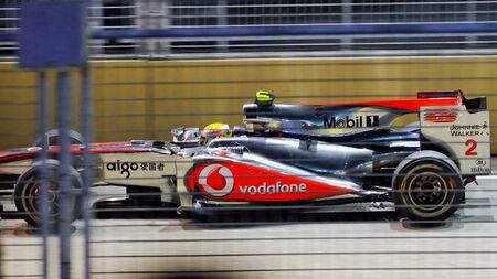 circuit brake: SINGAPORE - SEPTEMBER 26: Lewis Hamilton racing in his Mclaren during 2010 Formula 1 Singapore Singtel Grand Prix on September 26, 2010 in Singapore