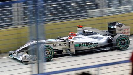 SINGAPORE - SEPTEMBER 26: Michael Schumacher racing in his Mercedes GP Petronas car during 2010 Formula 1 Singtel Singapore Grand Prix September 26, 2010 in Singapore