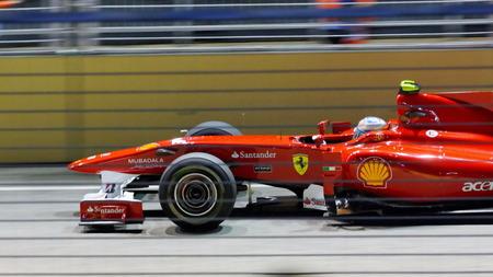 circuit brake: SINGAPORE - SEPTEMBER 26: Fernando Alonso racing in his Scuderia Ferrari F10 car during 2010 Formula 1 Singtel Singapore Grand Prix September 26, 2010 in Singapore