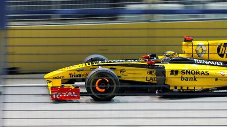 circuit brake: SINGAPORE - SEPTEMBER 26: Robert Kubica racing in his Renault car during 2010 Formula 1 Singtel Singapore Grand Prix September 26, 2010 in Singapore