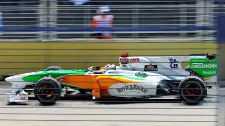 circuit brake: SINGAPORE - SEPTEMBER 26: Adrian Sutil racing in his Force India car during 2010 Formula 1 Singtel Singapore Grand Prix on September 26, 2010 in Singapore Editorial