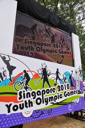 yog: SINGAPORE - JANUARY 10: Projector screen at the Singapore 2010 Youth Olympic Games logo launch January 10, 2009 in Singapore Editorial