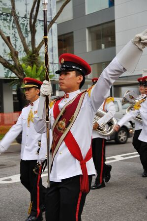 SINGAPORE - DECEMBER 07: Singapore Armed Forces Band B Drum Major signaling band to halt during President's changing of guards parade December 07, 2008 in Singapore