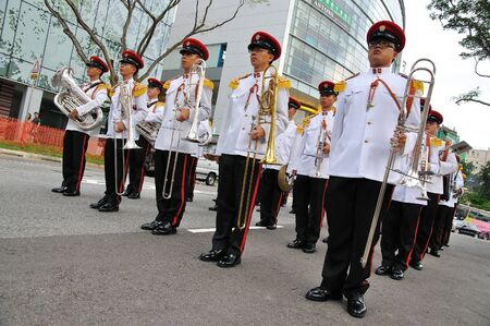 contingent: SINGAPORE - DECEMBER 07: Singapore Armed Forces Band B standing still during Presidents changing of guards parade December 07, 2008 in Singapore