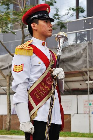 SINGAPORE - DECEMBER 07: Singapore Armed Forces Band B drum major holding mace during President's changing-of-guards parade December 07, 2008 in Singapore