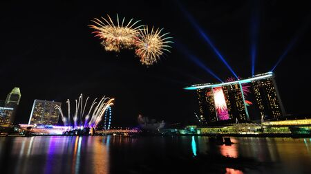 yog: SINGAPORE - AUGUST 14: Fireworks during Singapore Youth Olympic Games (YOG) 2010 Opening Ceremony at Marina Bay August 14, 2010 in Singapore