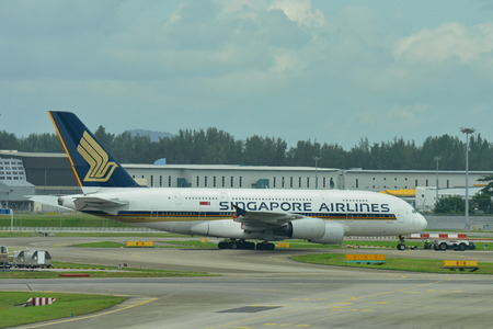 towed: SINGAPORE - JANUARY 10: Singapore Airlines Airbus 380 super jumbo being towed across taxi-way at Changi Airport on January 10, 2015 in Singapore