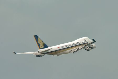 freighter: SINGAPORE - JANUARY 10: Singapore Airlines Cargo Boeing 747-400F freighter taking off at Changi Airport on January 10, 2015 in Singapore