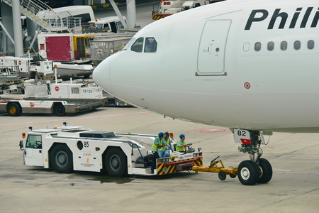 pushed: SINGAPORE - JANUARY 10: Philippines Airlines Airbus 330 being pushed back at Changi Airport on January 10, 2015 in Singapore Editorial
