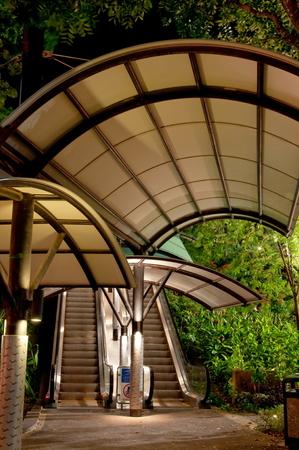 sheltered: Sheltered walkway to flight of escalators