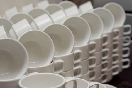 Neatly arranged white coffee cups Stock Photo