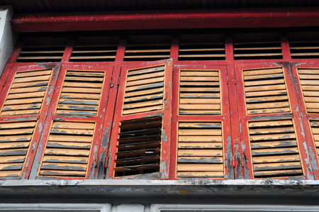 louvered: Old red and yellow louvered windows