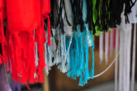 scarves: Colorful threads dangling from scarves