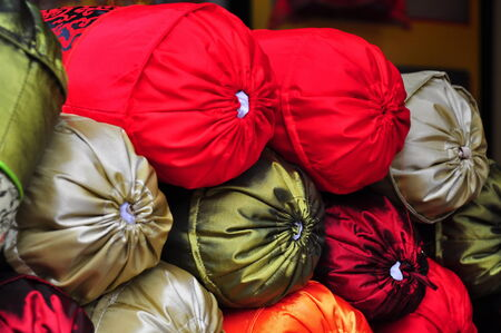 bolster: Row of bolsters with colorful silk covers