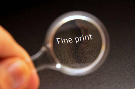 Read the fine print Archivio Fotografico