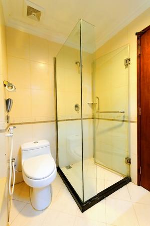 glass partition: Private bathroom in a luxury condominium