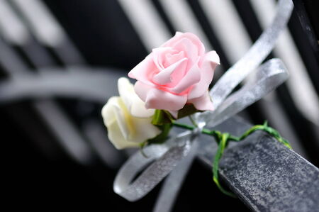 venue: White and pink roses as decor at wedding venue