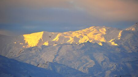 bathed: Snow mountains in New Zealand, bathed in golden sun light