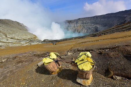 Kawah Ijen volcanic crater emitting sulphuric gas still used for sulphur mining in East Java, Indonesia