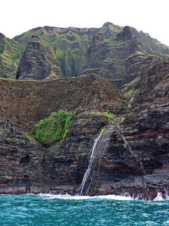 na: Waterfall along Na Pali Coast of Kauai Island, Hawaii