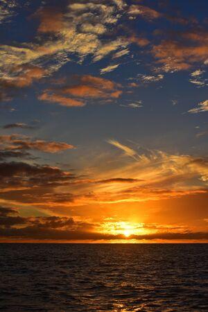kauai: Sun setting above the Pacific Ocean, Kauai, Hawaii Stock Photo