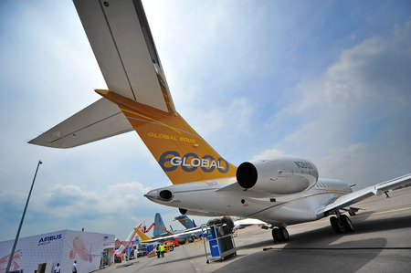 twin engine: SINGAPORE - FEBRUARY 9: Bombardier Global 6000 twin engine business jet on display at Singapore Airshow February 9, 2014 in Singapore
