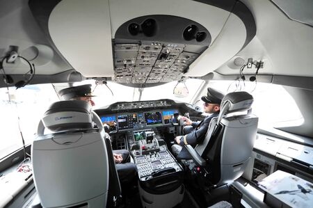 avionics: SINGAPORE - FEBRUARY 12: Modern cockpit of Qatar Airways Boeing 787-8 Dreamliner at Singapore Airshow February 12, 2014 in Singapore