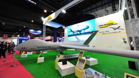 payload: SINGAPORE - FEBRUARY 12: Elbit Hermes 900 medium size medium altitude long endurance unmanned aerial vehicle (UAV) on display at Singapore Airshow February 12, 2014 in Singapore Editorial