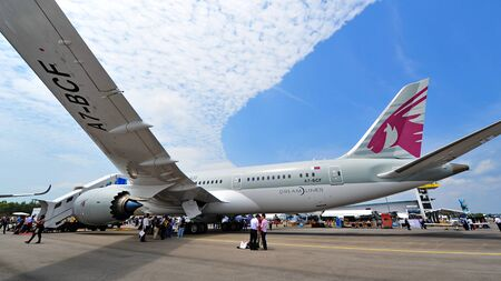 wing span: SINGAPORE - FEBRUARY 12: Fuselage and wing of Qatar Airways Boeing 787-8 Dreamliner at Singapore Airshow February 12, 2014 in Singapore