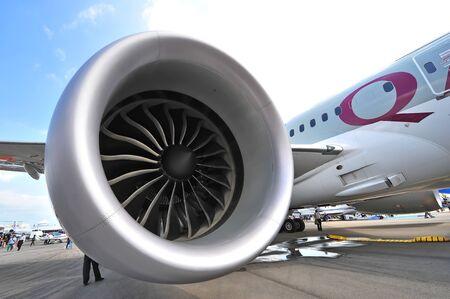 SINGAPORE - FEBRUARY 12: General Electric GEnx engine powering the Qatar Airways Boeing 787-8 Dreamliner at Singapore Airshow February 12, 2014 in Singapore