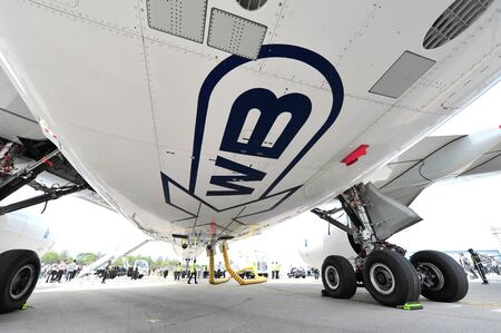 underside: SINGAPORE - FEBRUARY 12: Landing gears and underside of Airbus A350-900 XWB at Singapore Airshow February 12, 2014 in Singapore