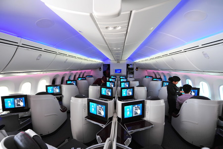 12 class: SINGAPORE - FEBRUARY 12: Luxurious and spacious business class seats in a Qatar Airways Boeing 787-8 Dreamliner at Singapore Airshow February 12, 2014 in Singapore Editorial