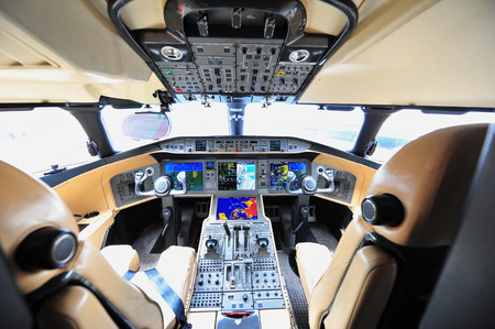 bombardier: SINGAPORE - FEBRUARY 12: Pilot cockpit of a Bombardier Global 6000 business jet at Singapore Airshow February 12, 2014 in Singapore