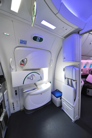 onboard: SINGAPORE - FEBRUARY 12: Exit door with high ceiling onboard Qatar Airways Boeing 787-8 Dreamliner at Singapore Airshow February 12, 2014 in Singapore Editorial