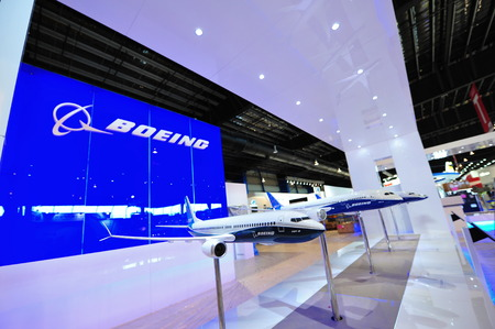 SINGAPORE - FEBRUARY 9: Various Boeing aircraft models on display, including 737-8 Max, 787 dreamliner, at Singapore Airshow February 9, 2014 in Singapore Editorial