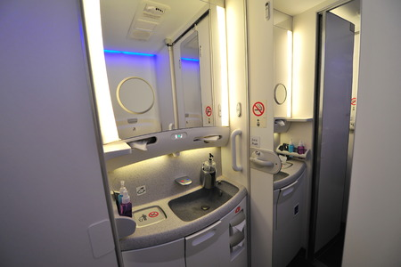 onboard: SINGAPORE - FEBRUARY 12: Interior of lavatory onboard Qatar Airways Boeing 787-8 Dreamliner at Singapore Airshow February 12, 2014 in Singapore