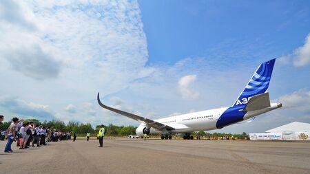 msn: SINGAPORE - FEBRUARY 12: Airbus A350-900 XWB being towed in for Singapore Airshow February 12, 2014 in Singapore Editorial
